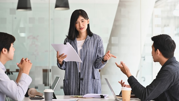 Young woman startup manager present in meeting office room.