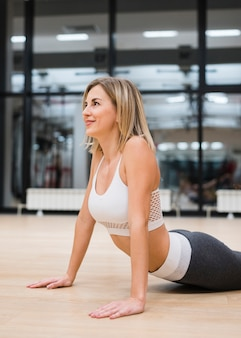 Young woman stretching at the gym