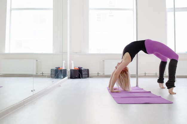 Young woman stretching her legs aafter workout, yoga and pilates concept