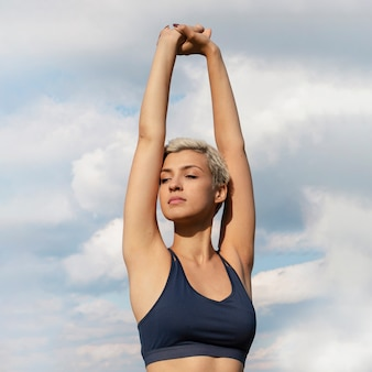 Young woman stretching in nature