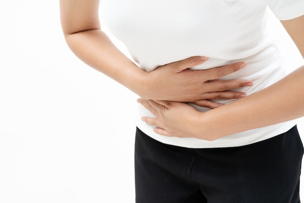 Young woman suffer from abdominal pain feeling stomach ache, symptom of pms