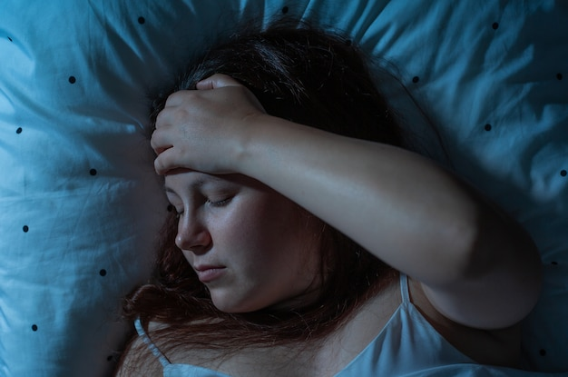 Young woman suffering from the chronic insomnia, sleep disorder
