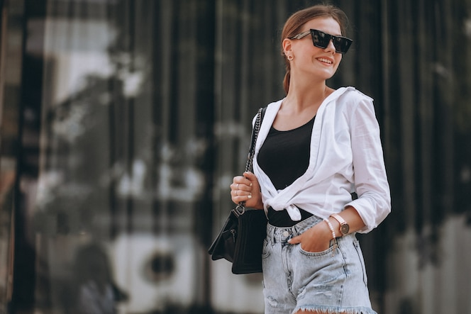 Young woman in summer outfit in town