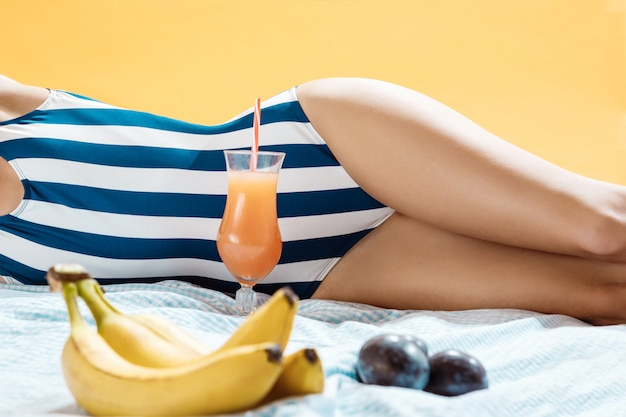 Young woman sunbathing with striped swimwear