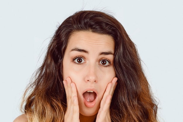 Young woman surprised.