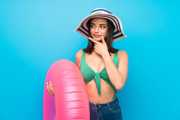 Young woman in swimsuit in summer holidays thinking an idea