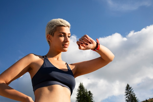 Young woman taking a break from running