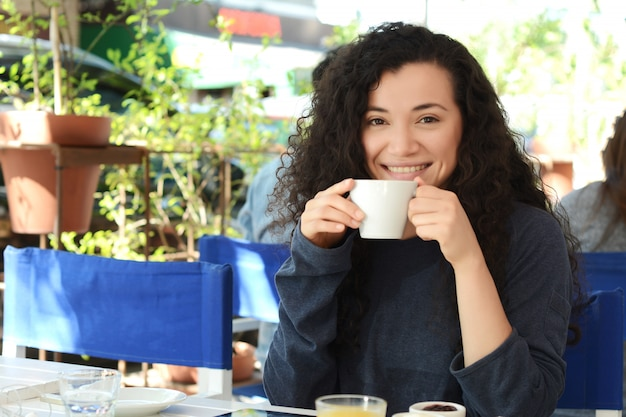 Young woman taking a coffee break