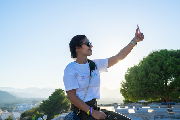 Young woman taking a photo herself