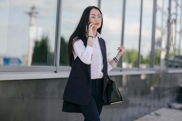 Young woman talking on a phone
