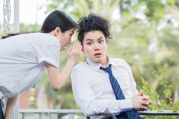 Young woman tell bad news to business man in shocked