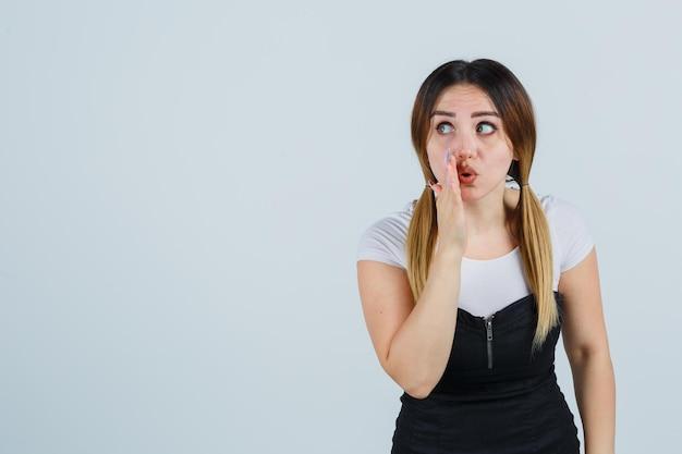 Young woman telling a secret