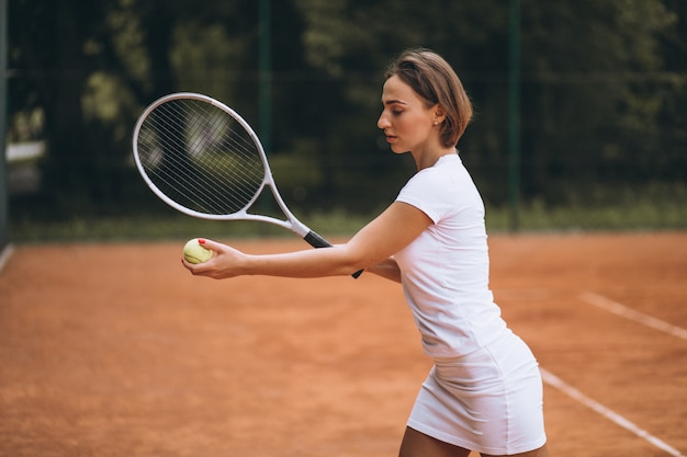 Young woman tennis player at the court