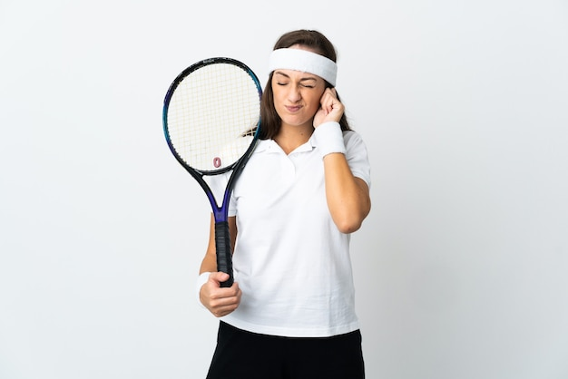 Young woman tennis player over isolated white background frustrated and covering ears