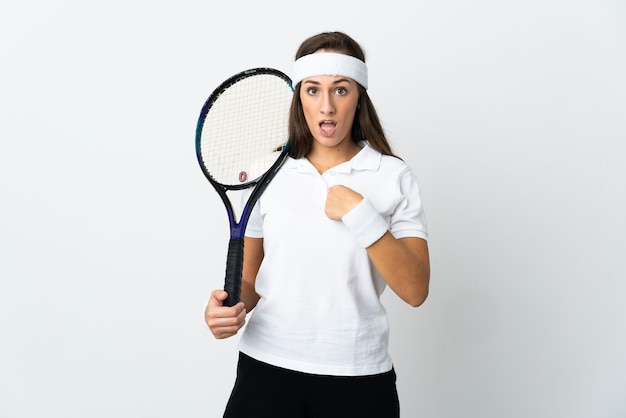 Young woman tennis player over isolated white background with surprise facial expression