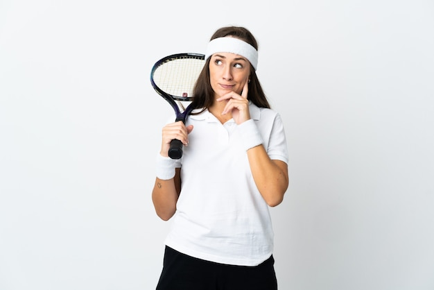 Young woman tennis player over isolated white having doubts and thinking
