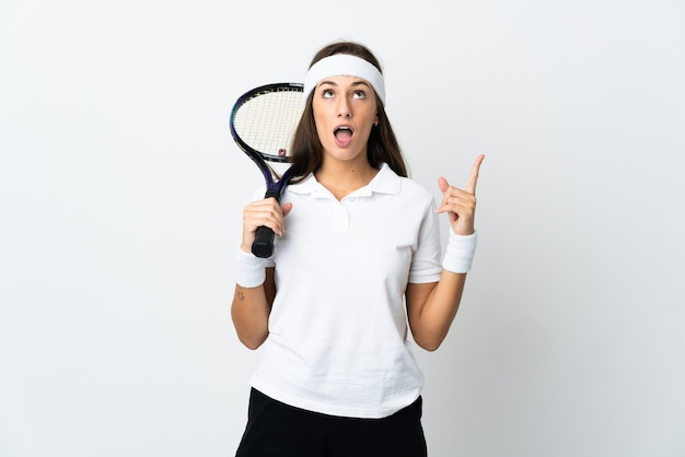 Young woman tennis player over isolated white thinking an idea pointing the finger up