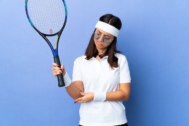 Young woman tennis player with pain in elbow