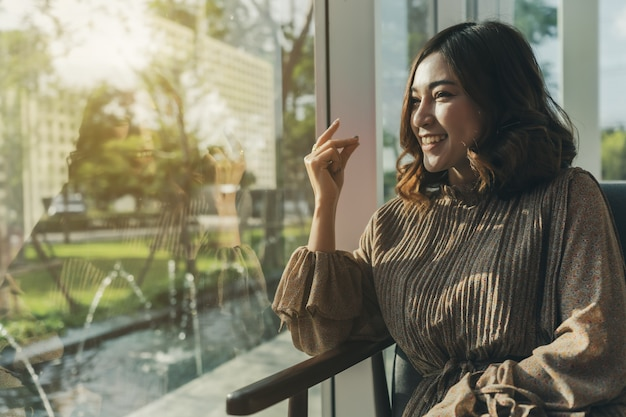 Young woman thinking a good idea at window