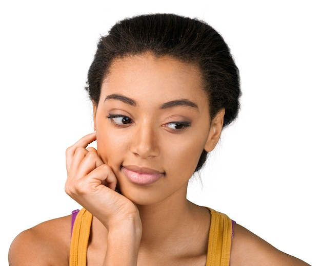 Young woman thinking with hand on face - isolated