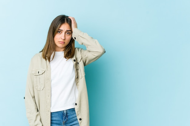 Young woman tired and very sleepy keeping hand on head