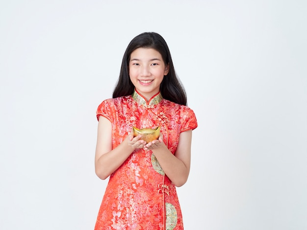 Young woman in traditional chinese dress showing chinese gold