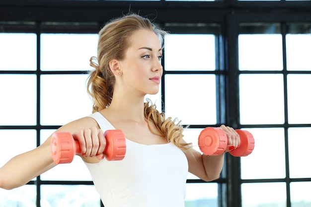 Woman holding the dumbbell