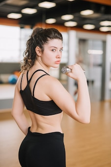 Young woman training at the gym