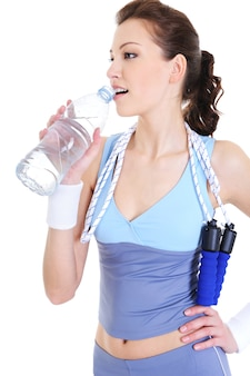 Young woman at the training recreation drinking water