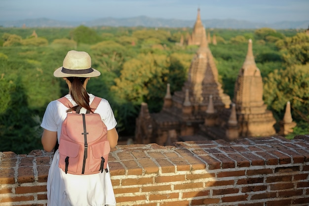 Young woman traveling backpacker with hat