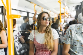 Young woman traveling by bus