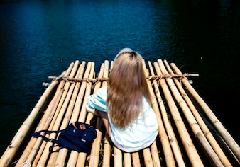 Young woman traveling on a raft