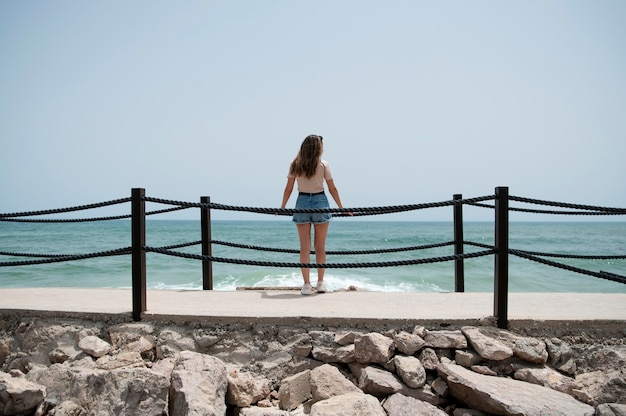 Young woman traveling without covid by the sea