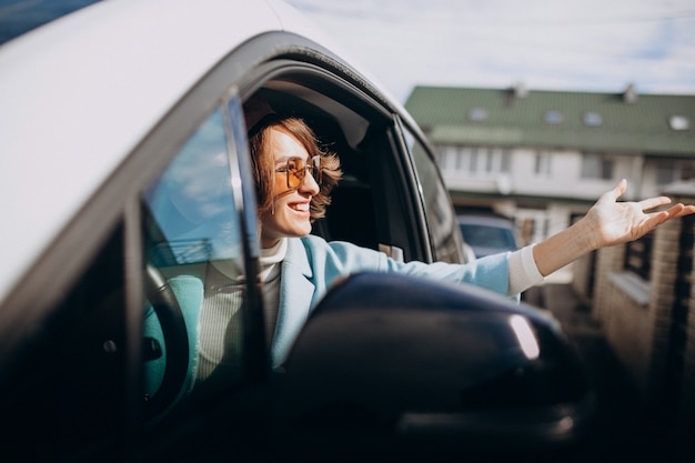 Young woman travelling by electric car
