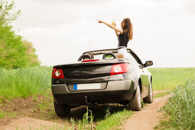 Young woman on a trip in a car