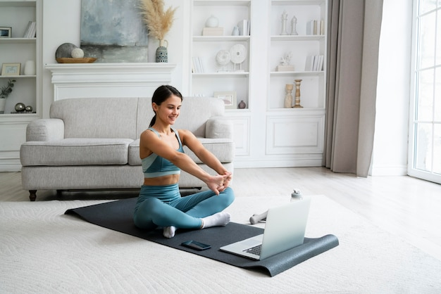 Young woman using a fitness mat to workout