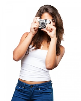 Young woman using her vintage camera