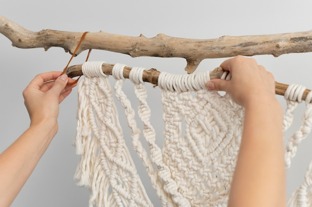 Young woman using the macrame technique