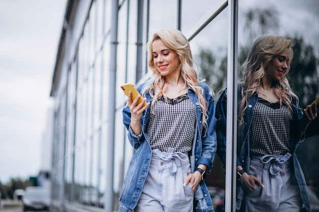 Young woman using phone outside