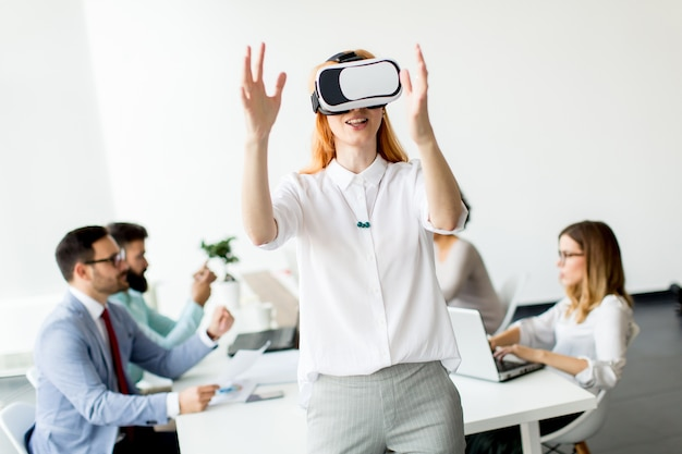 Young woman using virtual reality simulator in the office