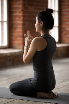Young woman in vajrasana pose