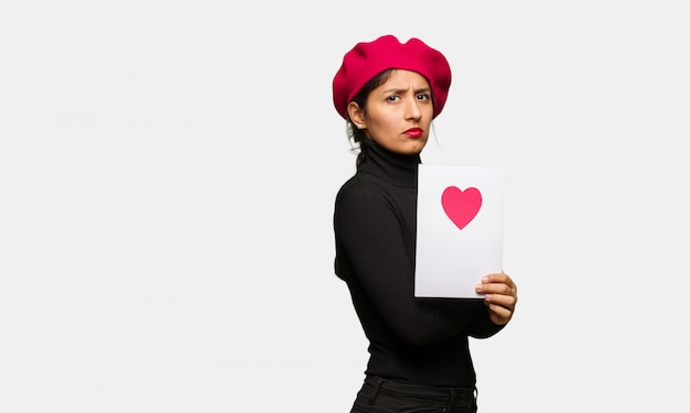 Young woman in valentines day looking straight ahead