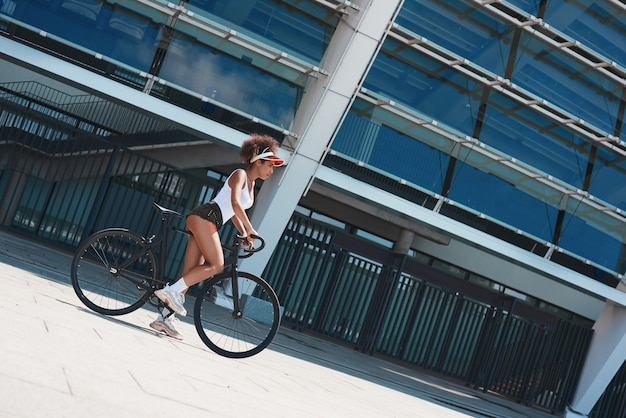 Young woman in visor free style on the street riding bike motiva