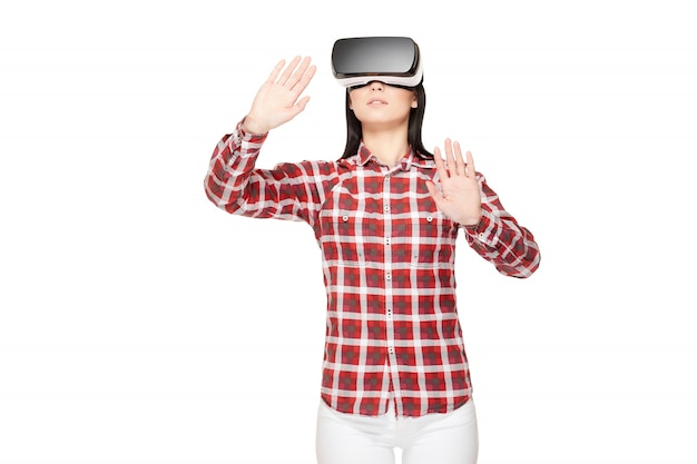Young woman in vr headset traveling in cyberspace.