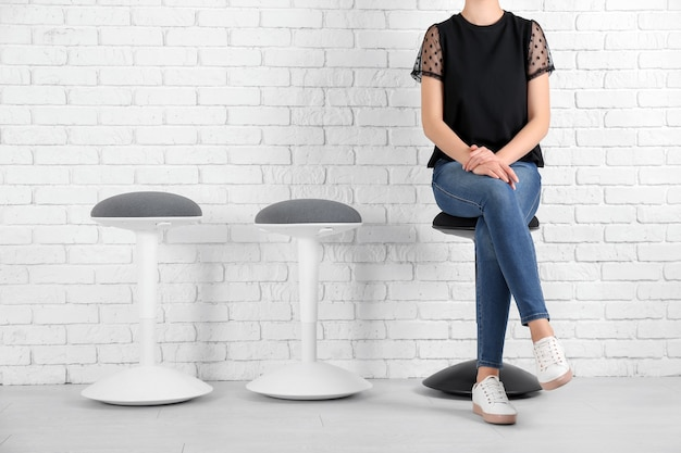 Young woman waiting for job interview indoors