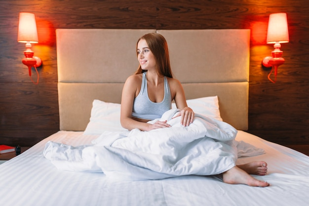 Young woman wake up in the morning, awake