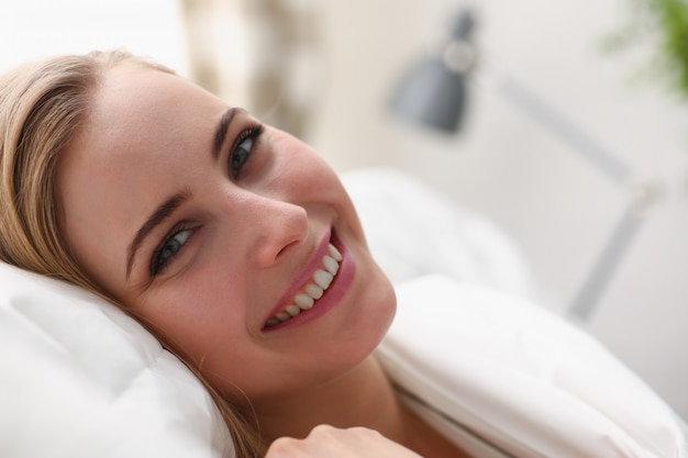 Young woman waking up in the morning