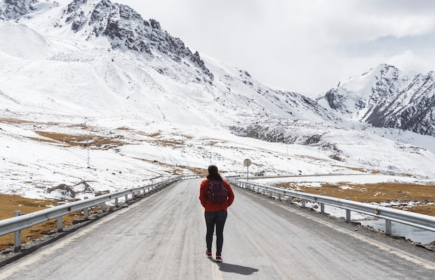Young woman walking on the karakoram highway