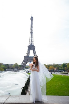 Young woman walks in white lace dress, high-heeled shoes, paris,