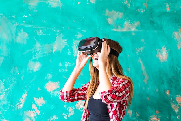 Young woman watching though the vr device.
